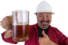 喝安全帽工作者的愉快的啤酒 免版税图库摄影