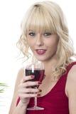 喝红葡萄酒的可爱的少妇 免版税图库摄影