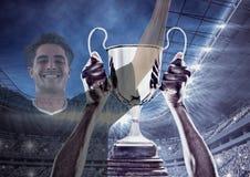 喝酒的足球运动员杯子和两个图象是叠加 图库摄影