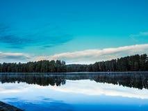 喵喵叫湖3日落安大略阿尔冈金省立公园 库存图片