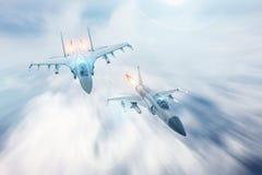 喷气式歼击机拦截伴随另一架战斗机 冲突,战争 航空航天部队 图库摄影