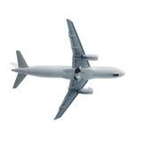 喷气机在白色天空的飞机着陆 免版税库存照片