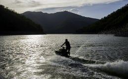 喷气机滑雪在湖 图库摄影