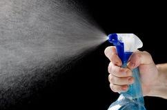 喷洒的液体擦净剂 免版税库存照片