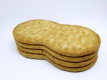 嘎吱咬嚼的棕色麦子薄脆饼干 免版税图库摄影