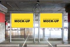 嘲笑两在杆的广告牌在停车场 库存照片