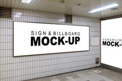 嘲笑在壁角墙壁的广告牌 免版税库存照片