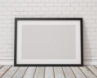 嘲笑在白色混凝土墙和葡萄酒地板上的空白的黑水平的画框 免版税图库摄影