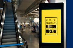 嘲笑在黑背景的垂直的广告牌在电梯附近 免版税图库摄影