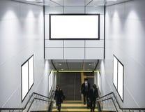 嘲笑横幅和海报在地铁站商人  免版税库存照片