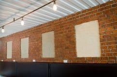 嘲笑海报框架或照片框架在墙壁上 库存图片
