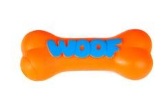 嚼狗查出的橙色plasgtic玩具白色 库存照片