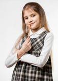 嚼铅笔的体贴的女小学生反对白色背景 库存照片