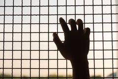 囚犯的手 免版税库存图片