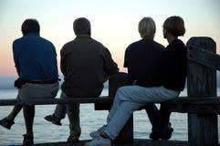 四个人剪影 免版税库存照片