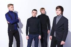 四个典雅的年轻人 免版税库存照片