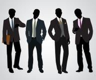 四个商人剪影 免版税库存照片