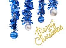 四个圣诞节球和圣诞快乐 免版税库存图片