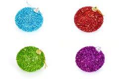 四个圣诞节球,隔绝在白色背景 库存照片