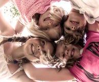 四个女孩一点 免版税图库摄影