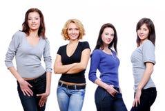 四个女孩愉快的性感的年轻人 免版税图库摄影