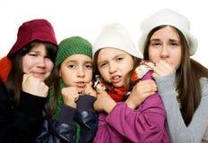 四个女孩装备冬天年轻人 免版税图库摄影