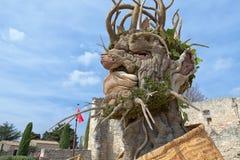 四个季节`是四个巨型头雕塑系列,代表年的季节中的每一 艺术家菲利普Haas 免版税图库摄影