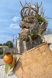 四个季节`是四个巨型头雕塑系列,代表年的季节中的每一 艺术家菲利普Haas 免版税库存图片