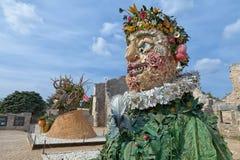 四个季节`是四个巨型头雕塑系列,代表年的季节中的每一 艺术家菲利普Haas 图库摄影