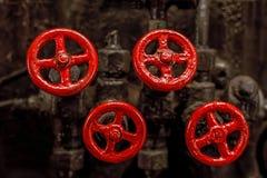 四个红色阀门 免版税图库摄影