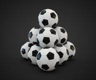 四个足球面对在白色的金字塔 库存照片