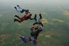 四个跳伞运动员 库存图片