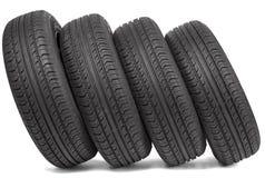 四个黑轮胎 库存照片