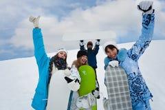 四乐趣mouintains snowborders 图库摄影