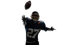 四分卫美国投掷的足球运动员人剪影 免版税库存图片