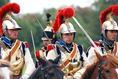 四匹战士骑乘马。 免版税库存照片