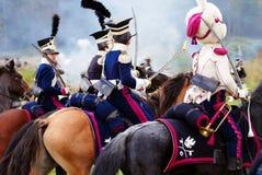 四匹战士骑乘马。 免版税图库摄影