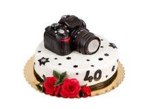 四十周年的生日蛋糕与现代DSLR照片照相机 库存照片