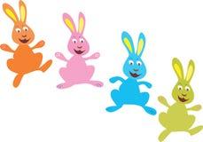 四只明亮地色的复活节兔子 库存照片