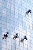 四名洗涤的视窗工作者 免版税图库摄影