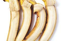 四在水平的行的部分被剥皮的香蕉谎言 库存图片