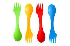 四塑料杂色野营的利器用工具加工匙子和叉子 免版税库存图片