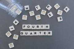 四季度词由方形的信件词制成在灰色背景 免版税库存照片