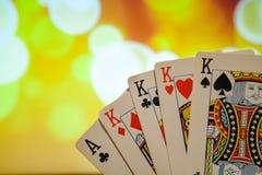 四张相同的牌啤牌拟订在被弄脏的背景赌博娱乐场比赛时运运气的组合 免版税库存照片