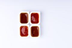 四快餐垂度在作为rect被安排的塑胶容器调味 免版税图库摄影