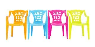 四把五颜六色的孩子椅子 库存图片