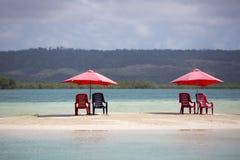 四把椅子和伞在热带海滩,委内瑞拉 库存图片