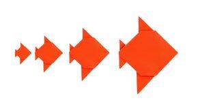 四条从纸的橙色鱼origami 库存图片