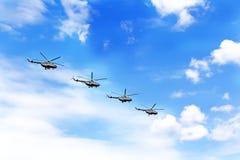 四架战争直升机游行  免版税库存图片