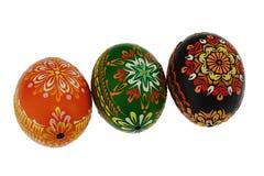 四美妙地做的家绘了在白色背景的复活节彩蛋 免版税库存照片